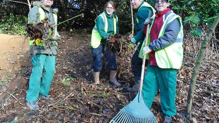 Growing Places The gardening team help clear a bank at Holywells Park in Ipswich to encourage bu