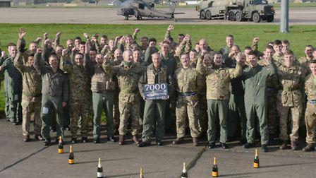 Major Chris Hearn MBE (centre) with colleagues from the Attack Helicopter (AH) Force