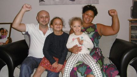 Steve and Andrea Thompson with their daughters, Violet and Olivia