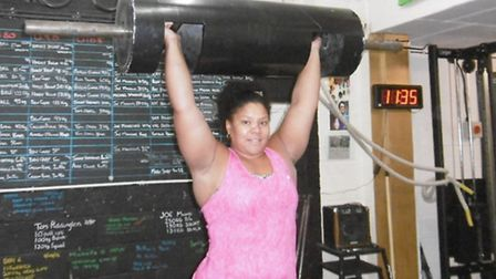 Strong woman Andrea Thompson in the gym. Log lift training