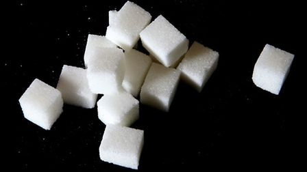File photo dated 26/06/14 of some sugar cubes. Revelations some British children are consuming their