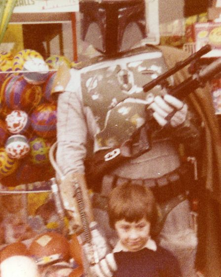 A young me with bounty hunter Boba Fett. Photo: Leslie Savage