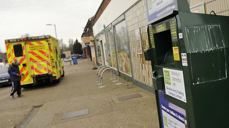 A man emptying a Salvation Army clothing donation bin was injured after winds knocked the metal door