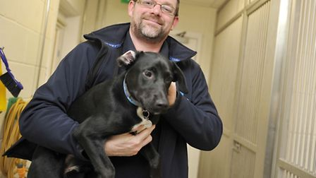 Centre manager Andy Gillon holds Riley in the puppy unit at the new Blue Cross Centre in Ipswich.