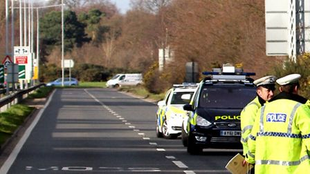 Poilce investigation work at the scene of the collision on the A12 at Martlesham Heath.