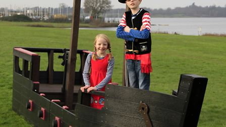 s: Connor, nine, and Martha, seven, from Colchester, test out the new Tudor galleon pirate ship from