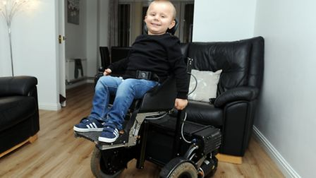 George Woodward is pictured with his new wheelchair at his home in Ipswich.