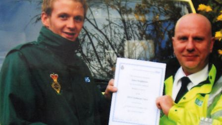 James Hodgkinson is pictured here receiving his certificate from the ambulance service