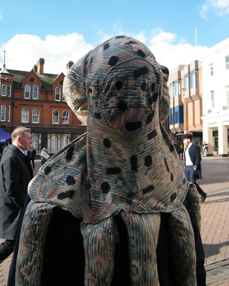 Charlie Clover, 16, wearing his octopus art project.