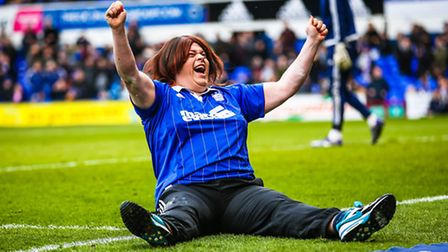 Jennifer Jo Lees celebrates three converted penalties in the fans half-time penalty shoot out compet
