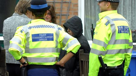A file picture of police staff talking to residents.