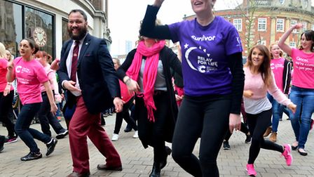 Flashmob dancers in the Buttermarket raising money for Cancer Research UK with help from the Mayor o