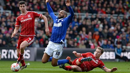 David McGoldrick cannot find a way through the Middlesbrough defence as Grant Leadbitter cuts him do