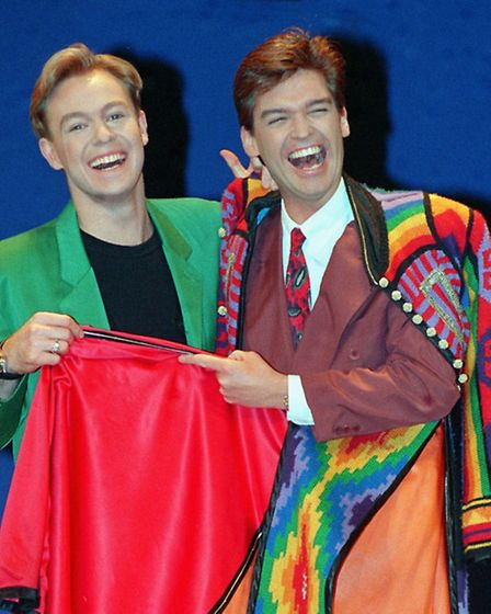 """Jason Dononvan (left), hands over his """"dreamcoat"""" to TV presenter Phillip Schofield at the London Pa"""