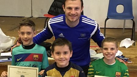 Tommy Smith with young fans Ross Dixon, Joe Watts and Freddie Mutimer