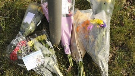 Floral tributes have been left at the scene of a crash which claimed the life of Ipswich motorcyclis