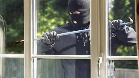 File picture of a man breaking entry into a house.