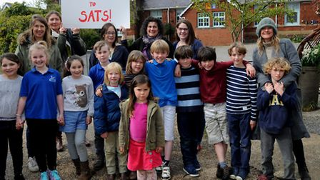 Pupils and students, outside Bealings Primary School, whowere due to strike today.