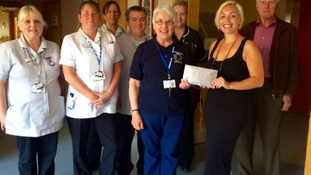 Professional singer Annika Rands presents the proceeds of her Sixties tribute show, held on Saturday