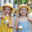 Sunny weather on Angel Hill in Bury St Edmunds. Grace King (4) and Eve King (4)(right) enjoy an ice-