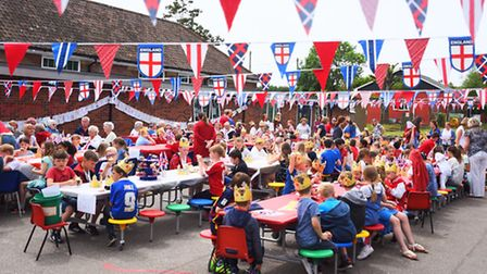 Bramford Primary celebrating Queen's 90th with a street party at the school.