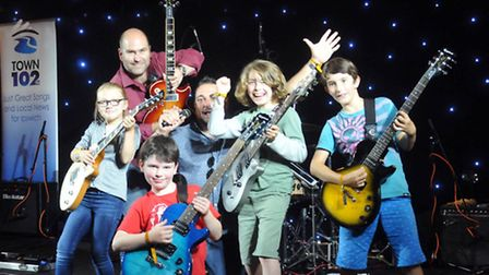 Town102's Wayne Bavin and head of Ipswich Guitar School Richard Deyn join four of the youngest perfo