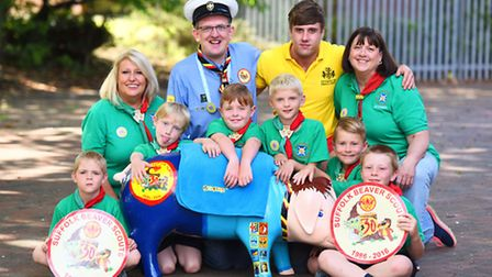 5th Ipswich Beavers posing with their pig and a special badge they have for the 30th anniversary of