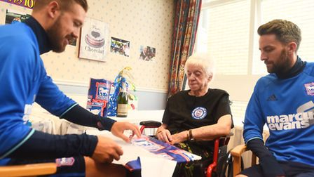 100 year old football fan Joyce Fisher gets a visit from Ipswich Town Players Luke Chambers and Cole