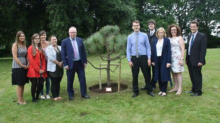 Law firm Prettys is planning to pland 110 trees in the Ipswich area. Ian Carr (Fifth right) and