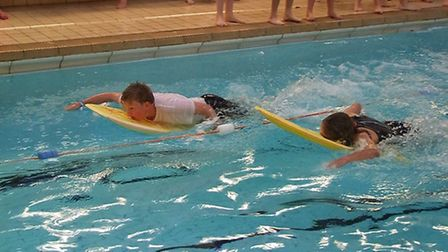 Tom Castle battles with Ruby Smith during the body board sprint