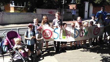 Parents and children are campaigning for a 20mph speed limit outside St Helen's Primary School.