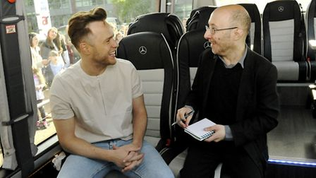 Wayne Savage interviews Olly Murs on his bus during a visit to Anglia Radio in Great Blakenham.