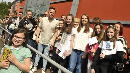 Fans have their photos taken with Olly Murs during his visit to Anglia Radio in Great Blakenham. Pho