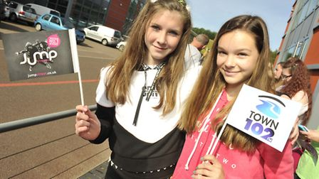 Allanah Latham, 13, and Maisie Jones, 13 wait for Olly Murs during his visit to Anglia Radio in Grea