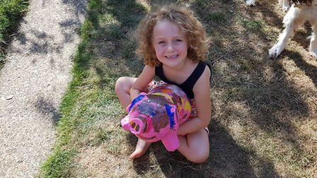 Amelia Felgate, five, with Sparkle - her very own Pigs Gone Wild creation
