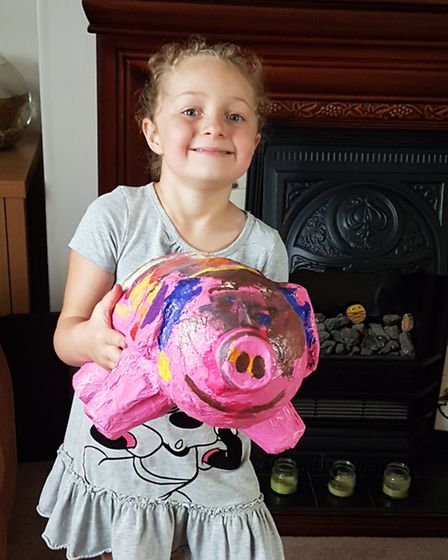 Amelia Felgate with her very own pig, inspired by the trail in Ipswich
