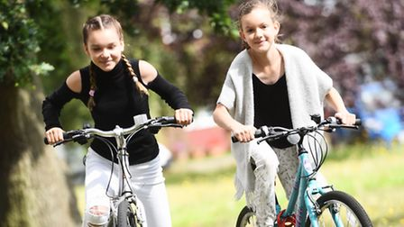 Sisters Maisie Jones, 13, and Demie Jones, 10, are doing a bike ride at a pub on August 28 in memory