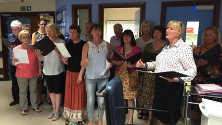 Members of the Ipswich Community Choir taking part in the Kissing it Better campaign at Ipswich Hosp
