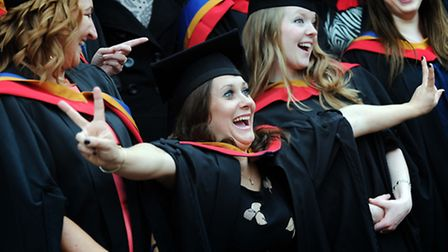 University Campus Suffolk graduates celebrate after the ceremony on Wednesday, 24 October.