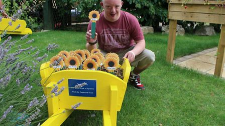 Richard Sanders with his sunflower emblem dedicated to his dad, Robert