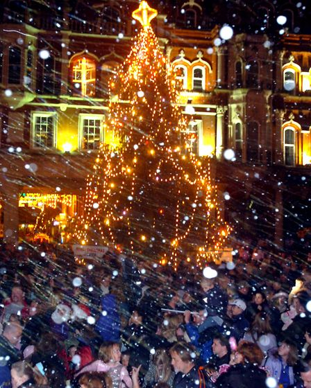 STAR NEWS 'Snow' falls on the crowd at the switch on the Ipswich Christmas Lights. PIC RICHARD
