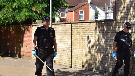 Police search the Jubilee Park area in Ipswich for weapons.