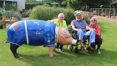 Norman Lloyd, Pigs Gone Wild project manager, with Richard and Debbie Mayhew who have donated �500 t