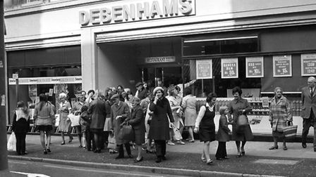Staff gather outside Debenhams in Ipswich after the fire alarms went off in April 1974