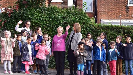 Maureen Voller with headteacher Clare Flintoff and some of the children.
