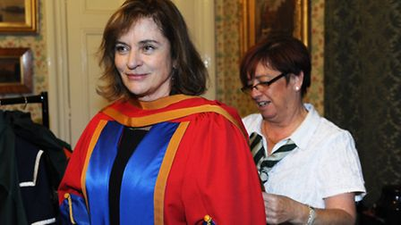Diana Quick prepares to be presented with her honorary degree from the University of Suffolk