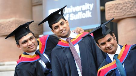 University of Suffolk graduates on the steps of the Town Hall on Ipswich's Cornhill
