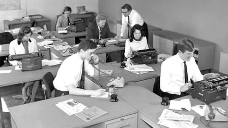 Reporters working with typewriters in the newsroom at Lower Brook Street in May 1966.
