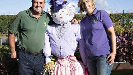 Paul and Ruth Goudy, owners of Kiln Farm Nursery pose with the winning scarecrow