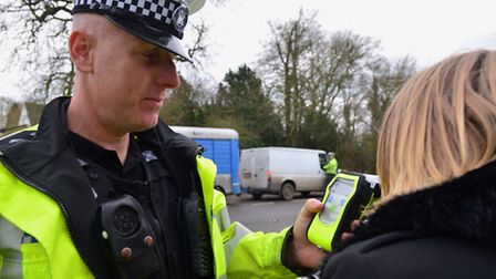 Inspector Julian Ditcham with the Drager Alcotest used by Suffolk Constabulary tests a motorist.